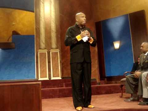 Apostle Darryl McCoy preaching at Higher Ground International