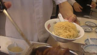 Hong Kong Food. Action in the Kitchen. Preparation of Noodles and Dumplings. Chinese Restaurant