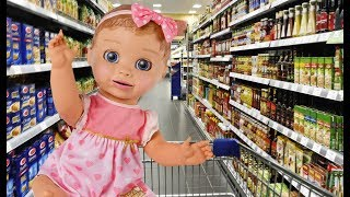 Dominika and baby doll playing in the supermarket