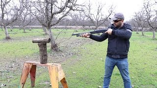 splitting wood with a shotgun