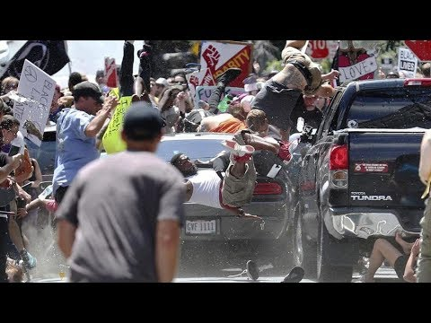Vehicle plows into peaceful marchers in Charlottesville