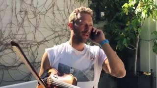 Chris Martin playing the violin