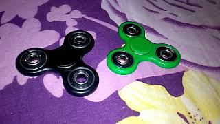Black fidget spinner vs Green fidget spinner