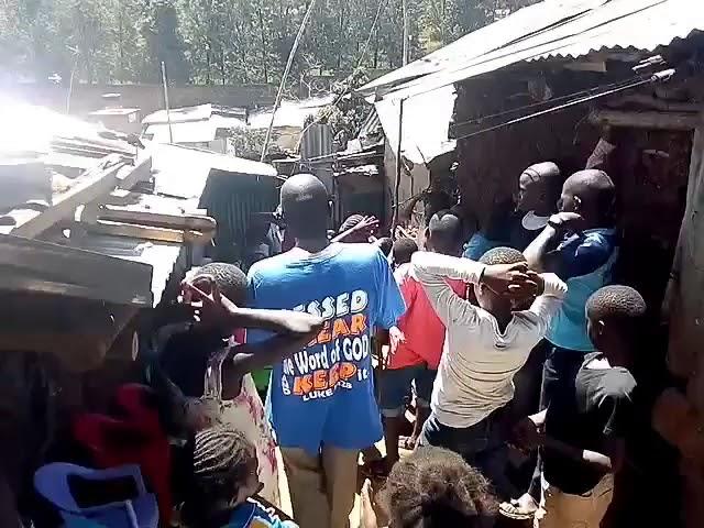 Children Singing to Jesus with Brother Joseph - WFF Kibera Slum Kenya