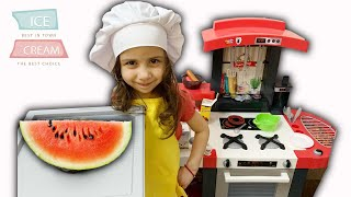 Saliha and Hafsa pretend play with cooking toys