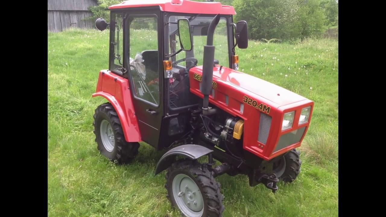 Трактор Беларус 320 (МТЗ) с почвенной фрезой в процессе работы .