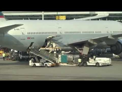 Cathay Pacific B777-200 loading cargo at Changi