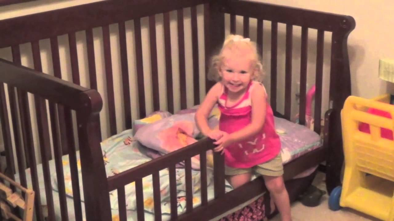 Baby 2 year old makes bed with the aid of tidy bed