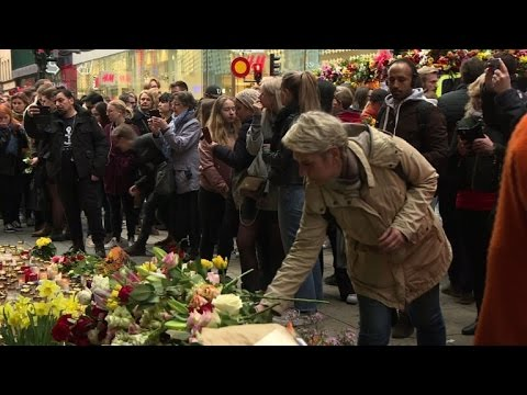 Stockholm store reopens after attack as Swedes pay tribute
