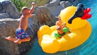 INSANE JUMP ON WORLD'S LARGEST RUBBER DUCKY POOL FLOATY!