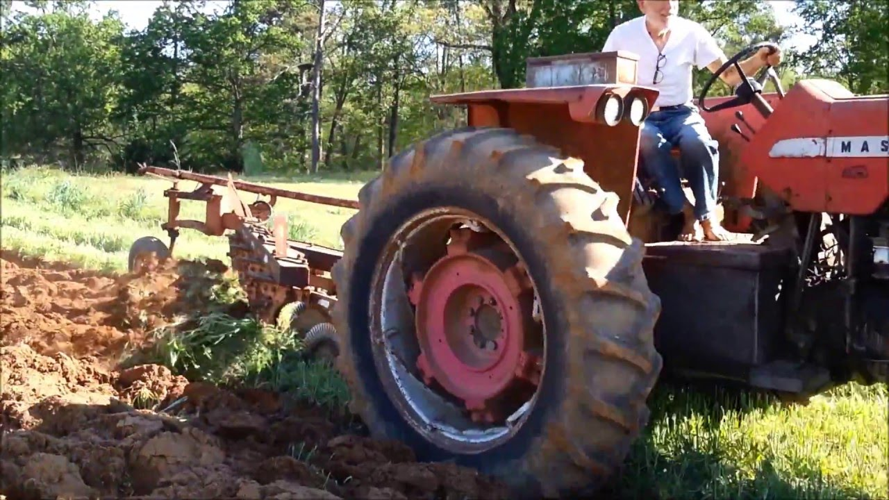 Plowing with 4 bottom semi mounted plow on MF 1080 - YouTube