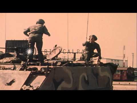 REFORGER 77: M-113 Armored Personnel Carrier moves to fueling point in Germany. HD Stock Footage