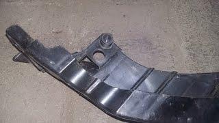 Пластиковое крепление для регулировки фар  на Volkswagen Polo.