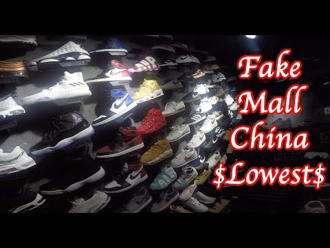 Fake sneakers shopping mall. Bootleg UA Jordan Yeezy nike adidas hype South China Guangzhou.