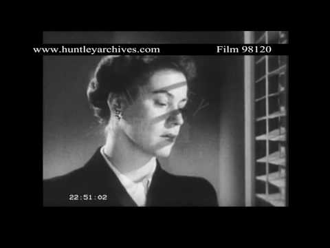 Film noir style sequence of woman leaving office.  Archive film 98120