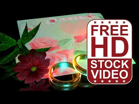 FREE HD video backgrounds – wedding rings with red flower and wedding invitation card on black backg