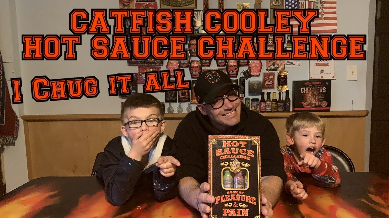 Catfish Cooley Book of Pleasure & Pain Hot Sauce Chug