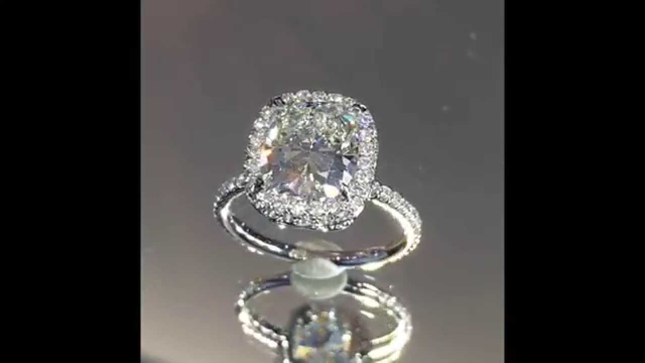 3 Carat Cushion Diamond Ring In Raised Halo
