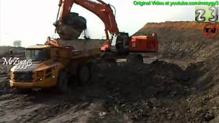 Articulated Dump Truck Volvo A40F Loading At Coal Mining