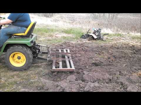 John Deere 316 pulling $25 DIY Cat 0 spike harrow