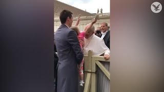 Young girl steals the Pope
