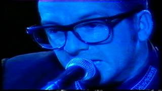 Elvis Costello/ Tramp The Dirt Down.