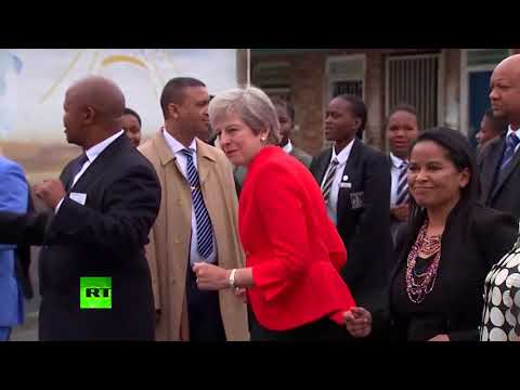 Theresa May caught dancing awkwardly in South Africa