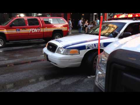 NY/NJ PORT AUTHORITY POLICE CRUISER SQUEEZING BY OPERATIONS OF FDNY ONSCENE OF A 2 ALARM FIRE.