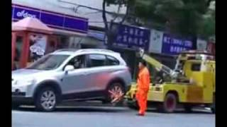 Shanghai Lady Drives Off With Tow Truck