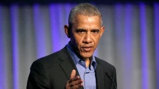 Obama invokes Nazi Germany, warns of political complacency