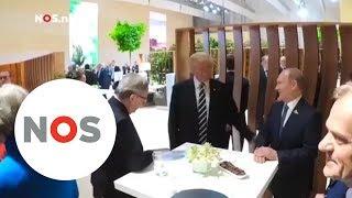 HANDDRUK: Trump en Poetin geven elkaar voor het eerst een hand