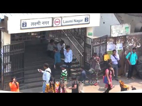 Passengers queue up as metro train approaches Laxmi Nagar station - Delhi