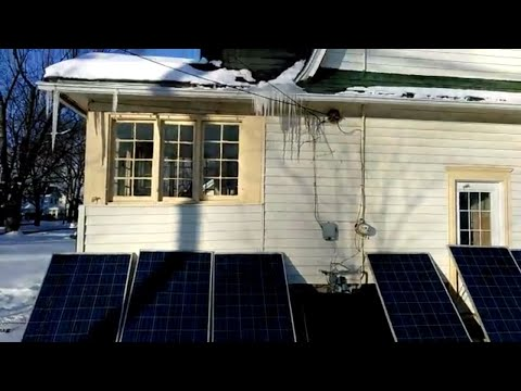 Ice Sickles Hanging Above solar Panels