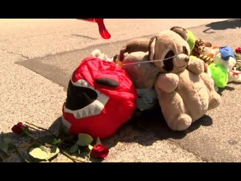 Crowds gather in remembrance of Michael Brown on 3rd anniversary of death