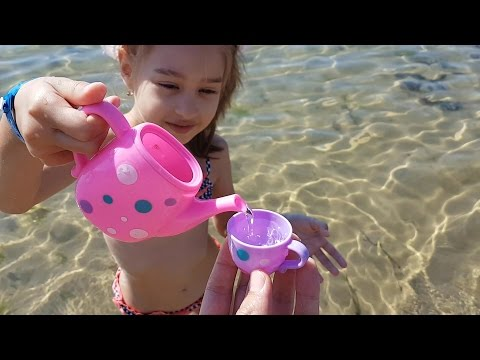Thumbnail: Kids playing on the beach . They making ice cream and cakes from sand. Video 2016