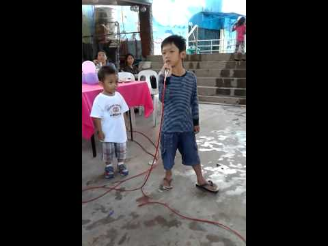 Jokjok singing No Arms Can Ever Hold You