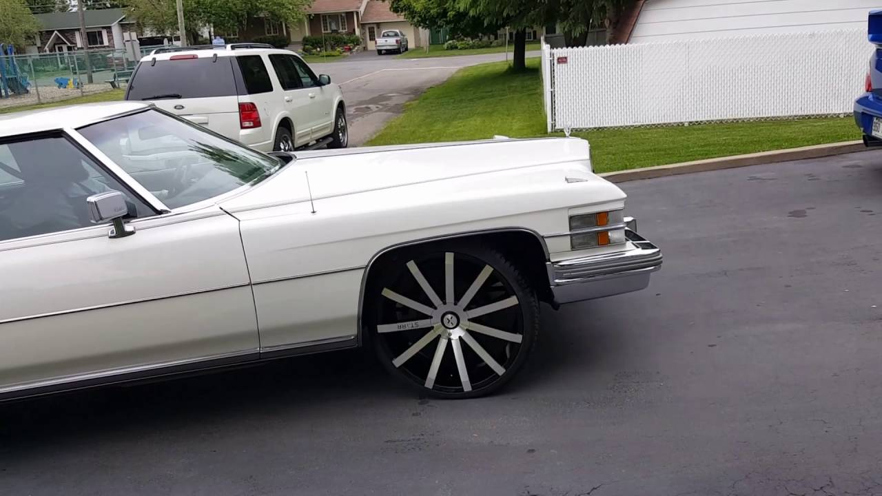 Cadillac Coupe DeVille 1974 on 24 inch rims auto detailing polished