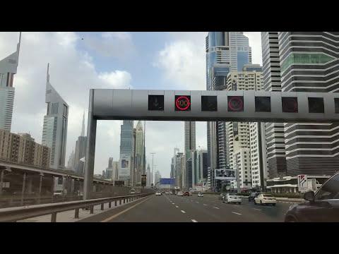 Exploring Dubai by car - Amazing beautiful buildings in Dubai on Sheikh Zayed Road via Uber