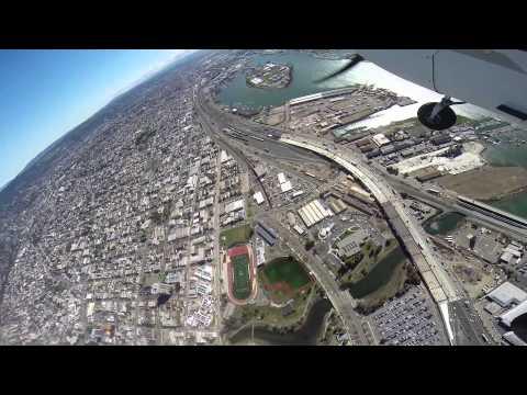 Return flight from Half Moon Bay Airport  to Oakland (OAK) over San Francisco...