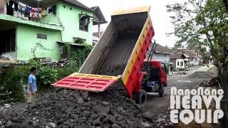 Toyota Dyna Dumper truck Dumping rock and gravel on reconstructed Road