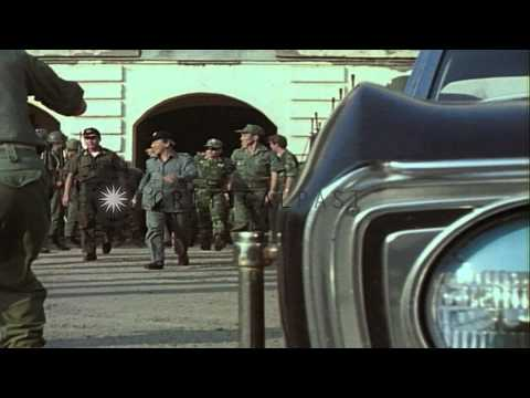 ARVN soldiers outside the headquarters building during the invasion of South Viet...HD Stock Footage