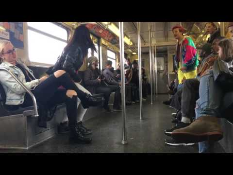 Entitled racist white women threatens black gay man on nyc train