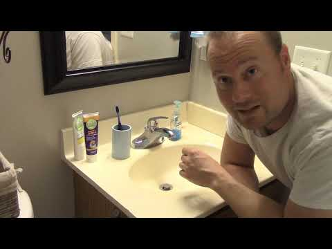 Clearing a bathroom sink drain youtube for Slow draining bathroom sink not clogged