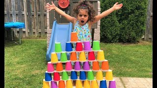 Sally pretend play Builds COLORFUL cup wall -fun kids video