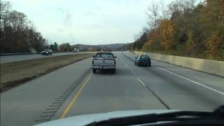 Road raging idiot, brake checks a semi with his son the the pickup. I-74 west at the Ohio-Indiana