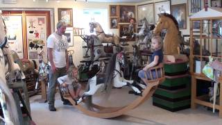 Kids Enjoying A Rocking Horse