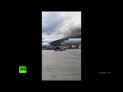 Cargo bursts into flames moment before it's loaded on US jet at Hong Kong airport