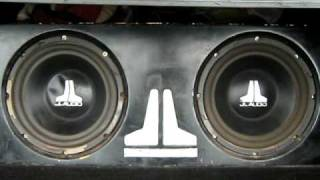 """2 10"""" JL audio subs and 700 watt compition amp"""