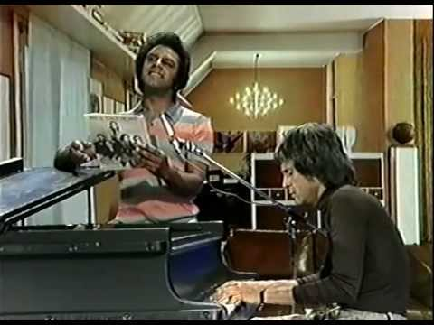 "Juan Carlos Calderon y Johnny Mathis ""Eres tú / Touch the wind"""