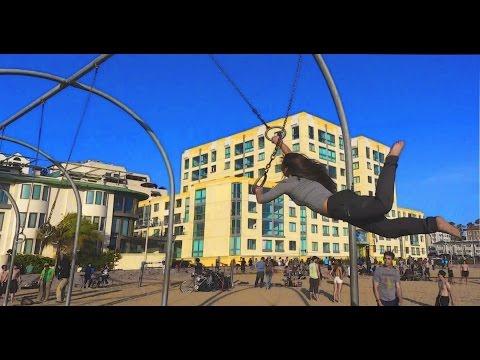 A pretty Girl flies on Traveling Rings, Santa Monica Pier, ORIGINAL MUSCLE BEACH